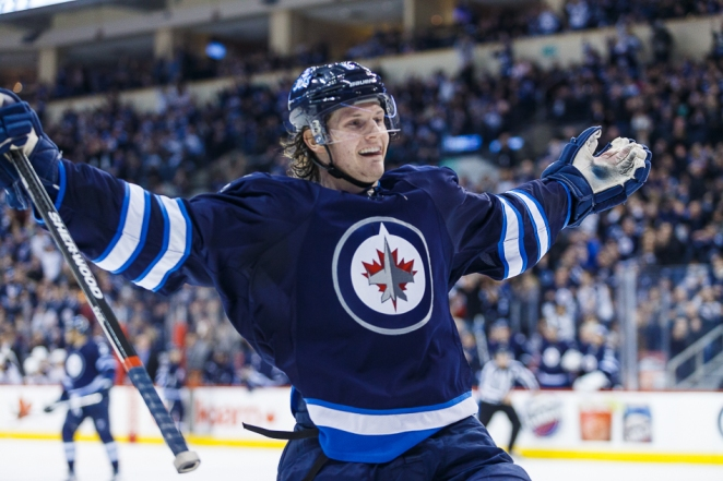 Winnipeg Jets defenceman Jacob Trouba (8) celebrates his goal against the Buffalo Sabres in NHL action at the MTS Centre, Dec. 31, 2013. SHAWN COATES PHOTO